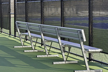 Benches in front of a Fence in Aurora IL around a tennis court