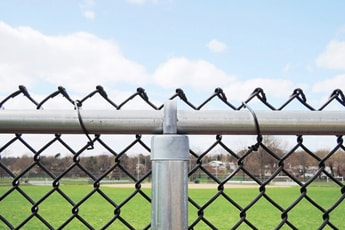 Commercial Fencing in Joliet IL in front of sports field