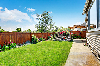 A backyard with a tall wooden Fence in Oak Brook IL