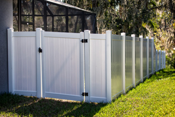 White vinyl fence with a latched gate made by a Fence Company in Rolling Meadows IL