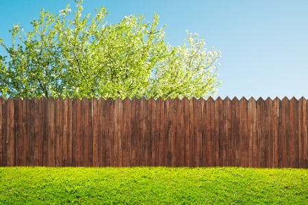A wood fence on a hill, installed by Fence Companies in Joliet IL