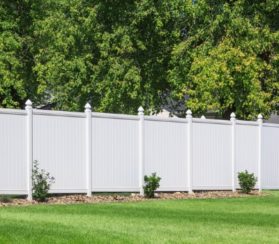 A Privacy Fence in Bolingbrook IL in front of a wooded area