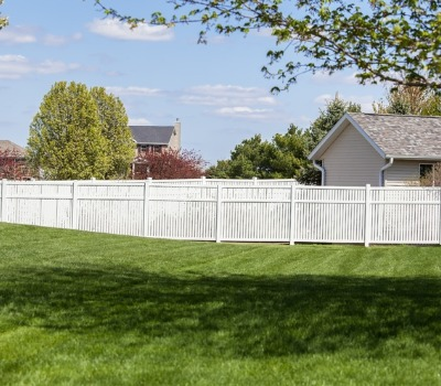 White Vinyl Fencing in Joliet IL along the back of a residential property