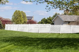 White Vinyl Fences in Joliet IL enclosing a backyard